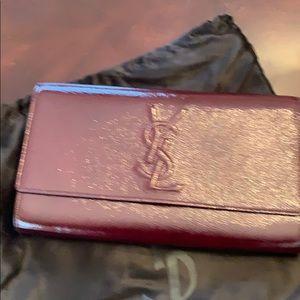 Yves Saint Laurent clutch bag maroon lkn